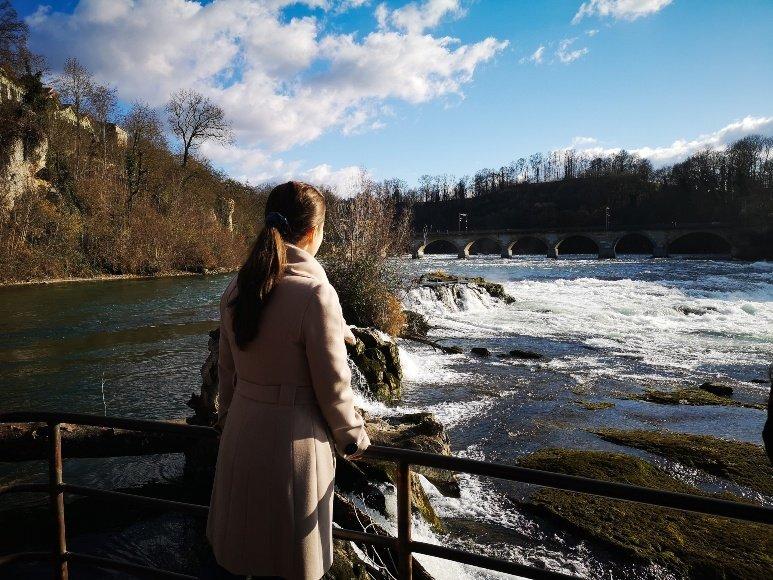 girl watching waterfall