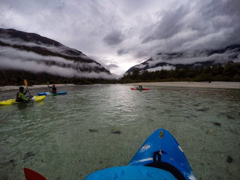 Kayaking among mist at dawn