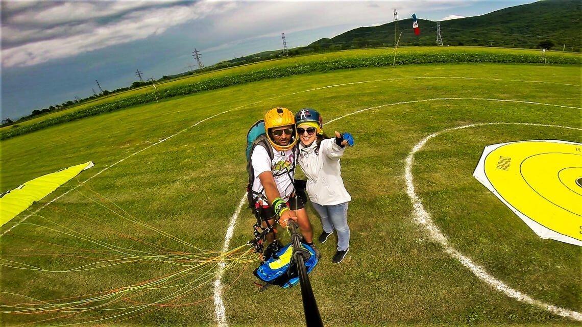 selfie girl with instructor after landing