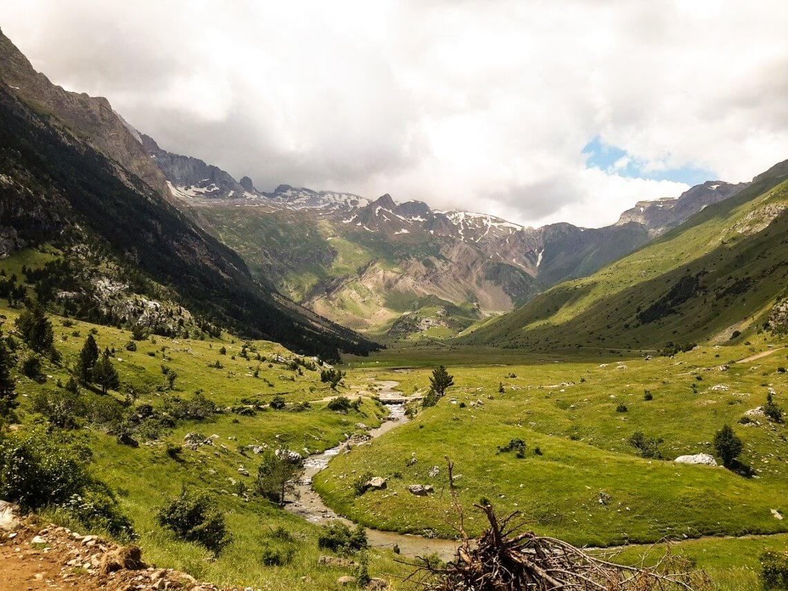 Valley, small river with mountains in the background